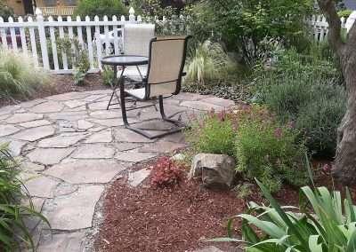 Cozy backyard rock patio