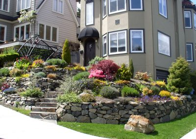 Retaining wall front yard landscape