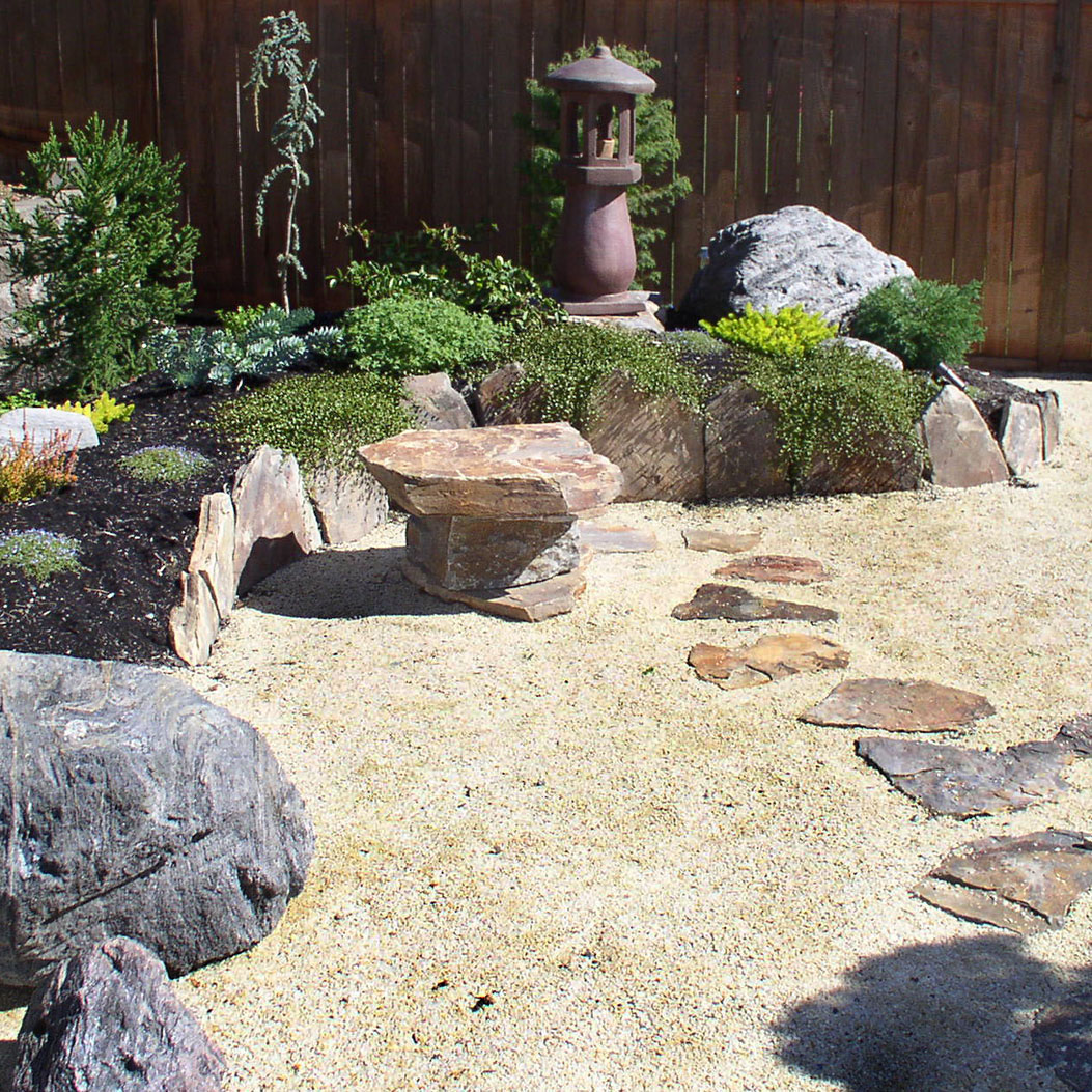 stepping stones in a hardscape landscaped backyard