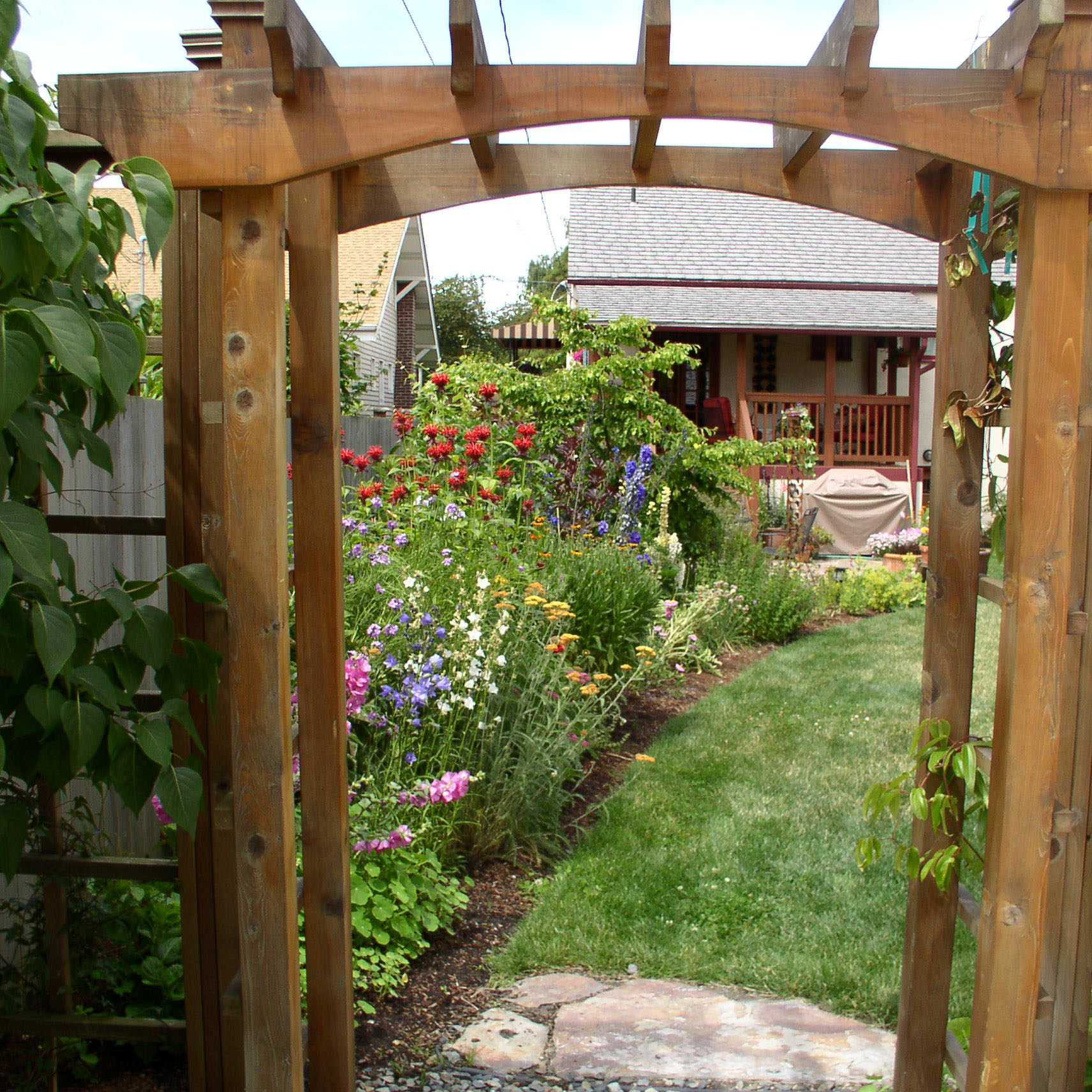 Wooden arbor entryway into a flower garden