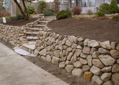 Rock retaining wall and stairs