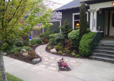 Front yard landscaping with pathway