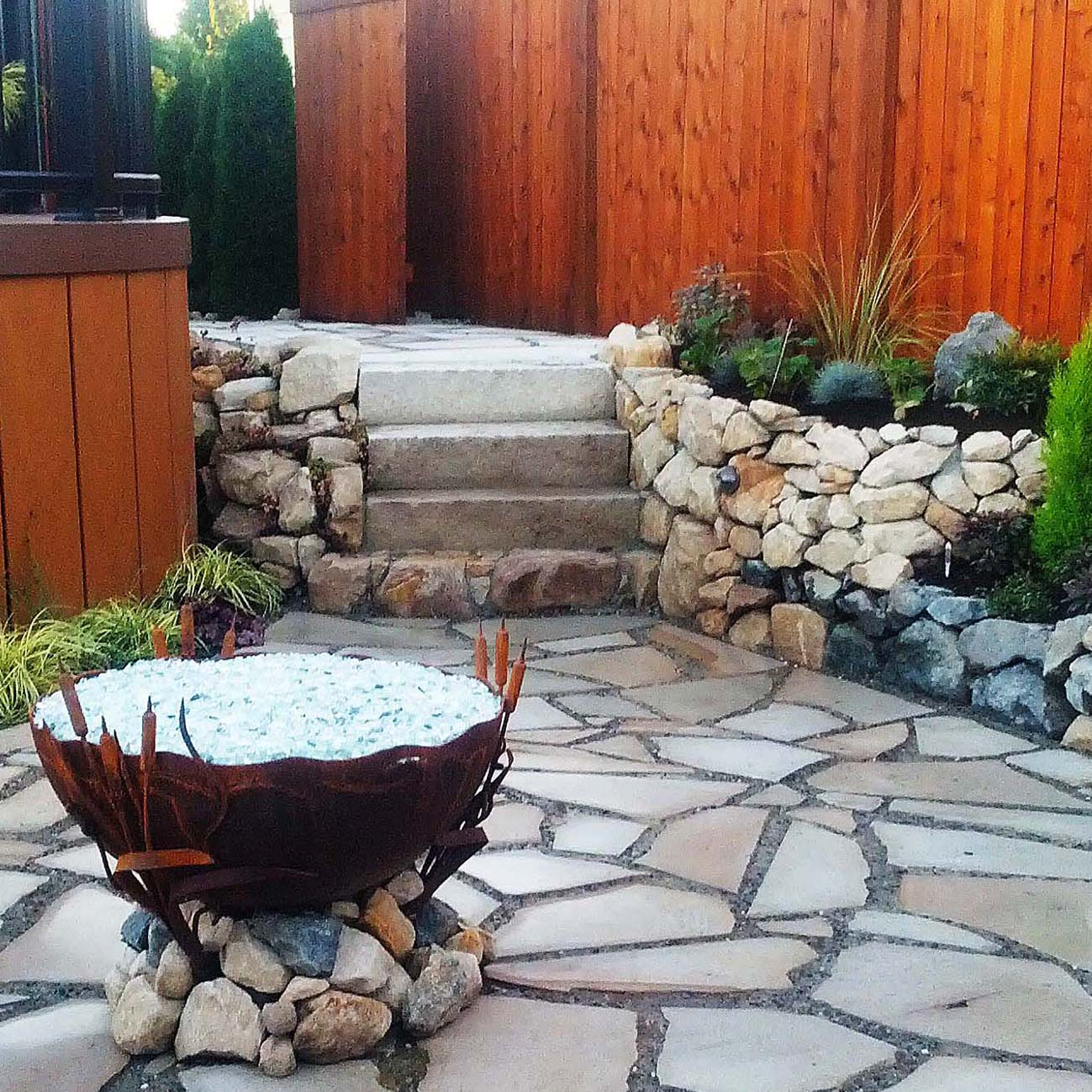 stone patio with stone staircase