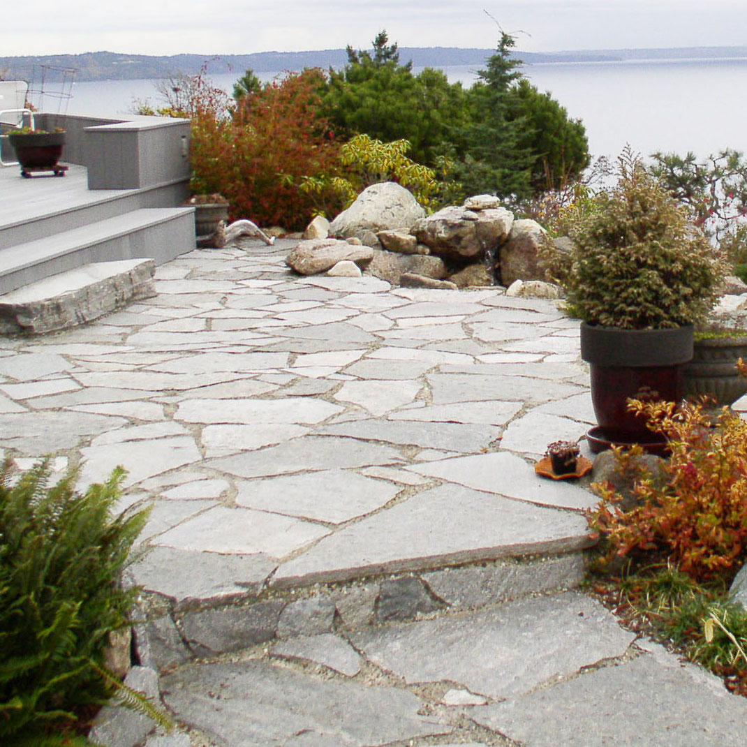 flagstone patio with steps in front yard