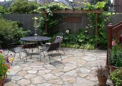 Flagstone Backyard Patio and beautiful landscape