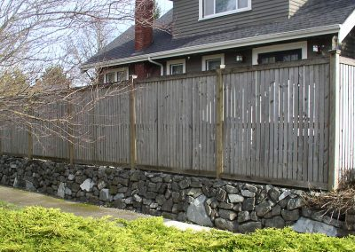 Custom wood fence and retaining wall