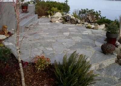 Flagstone patio overlooking water