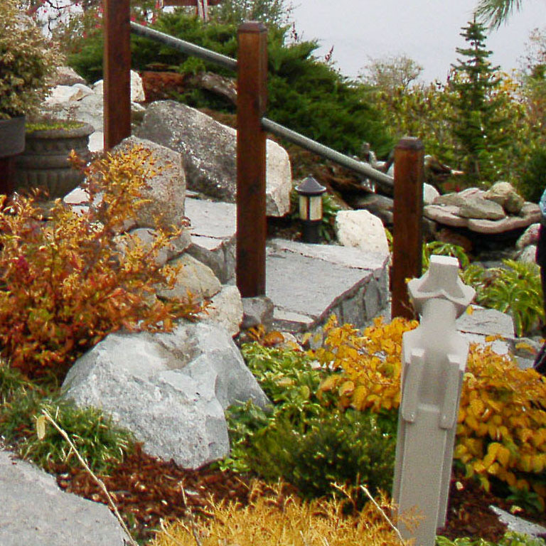 stone staircase adds beauty to the front yard landscaping