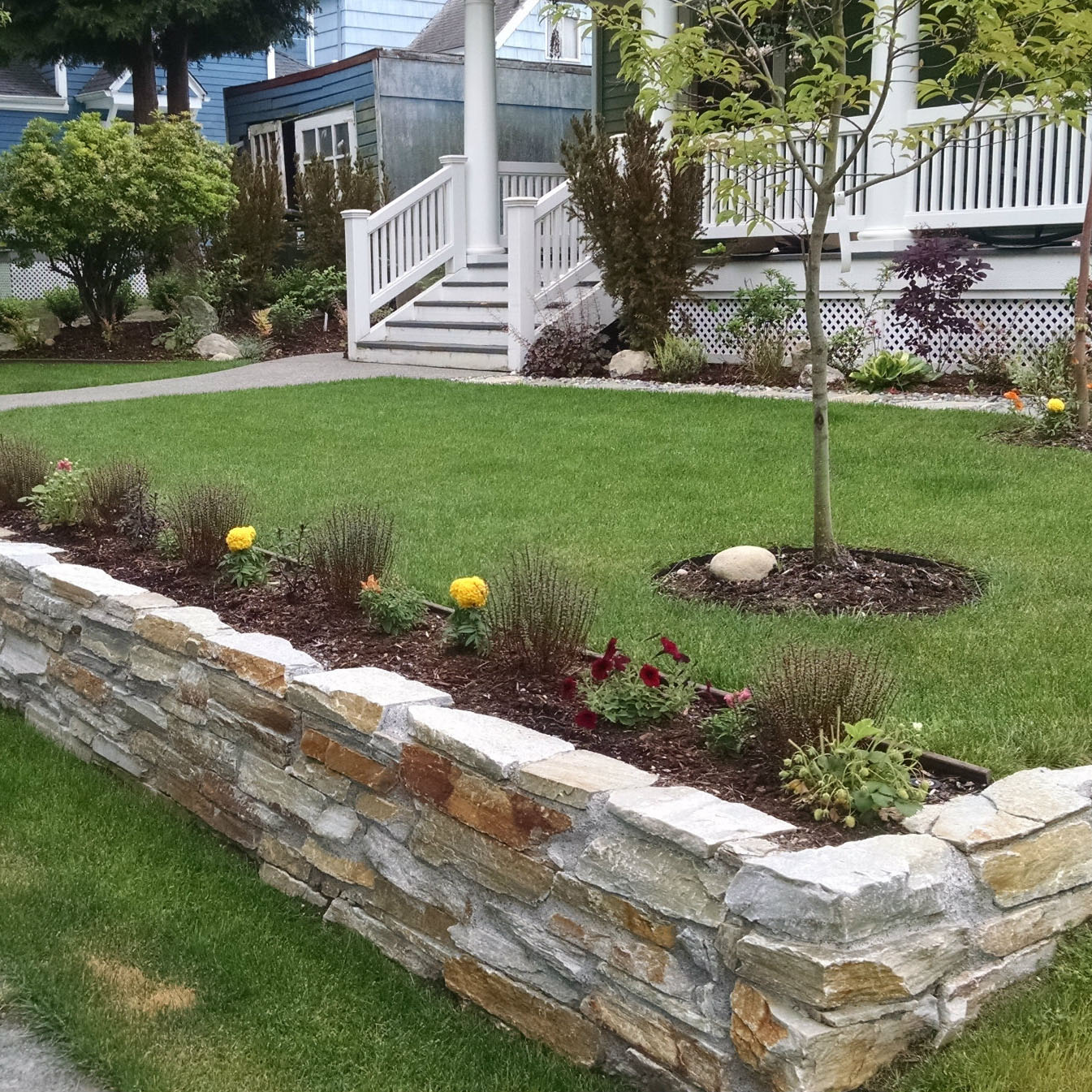 stone retaining wall in front yard landscaping