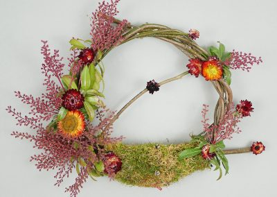 Moss and dried flower winter wreath