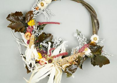 Fall wreath with dried flowers and corn