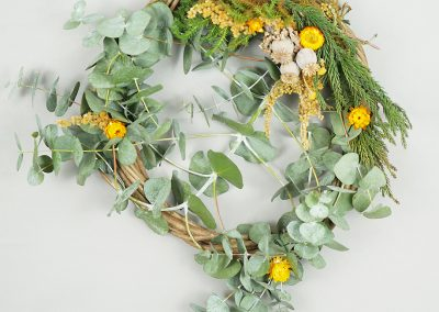 Wreath with eucalyptus, dried flowers and greenery